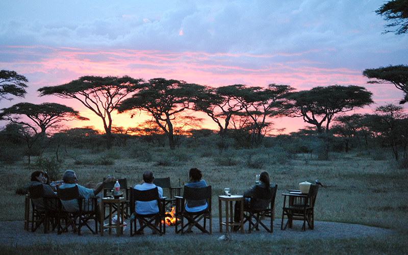 The group enjoying sunset in the Serengeti.